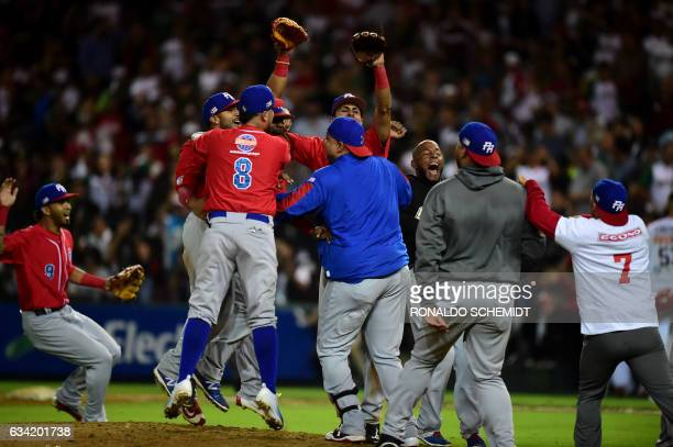 Players of Criollos de Caguas from Puerto Rico celebrate their victory against Aguilas de Mexicali from Mexico during the final of Caribbean Baseball...
