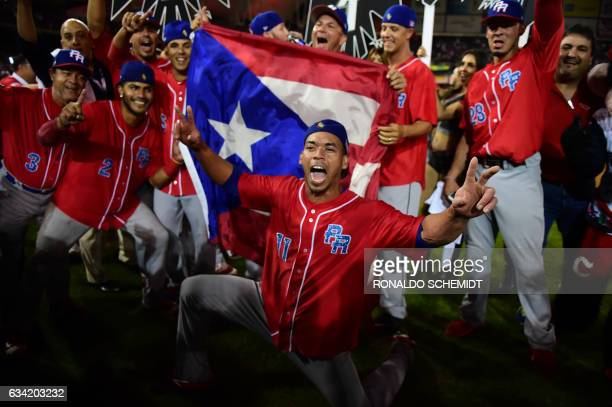 TOPSHOT Players of Criollos de Caguas from Puerto Rico celebrate their victory against Aguilas de Mexicali from Mexico during the final of Caribbean...
