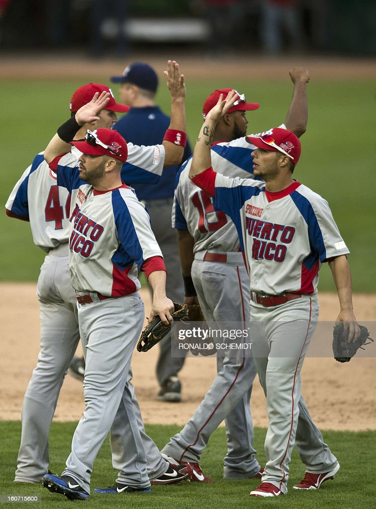 Players of Criollos de Caguas of Puerto Rico, celebrate their victory against Leones del Escogido of Dominican Republic, during the 2013 Caribbean baseball series, on February 4, 2013, in Hermosillo, Sonora State, in the northern of Mexico. AFP PHOTO/Ronaldo Schemidt