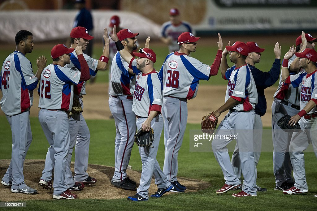 Players of Criollos de Caguas of Puerto Rico celebrate victory against Magallanes of Venezuela, during the 2013 Caribbean baseball series, on February 5, 2013, in Hermosillo, Sonora State, in the northern of Mexico. AFP PHOTO/Ronaldo Schemidt