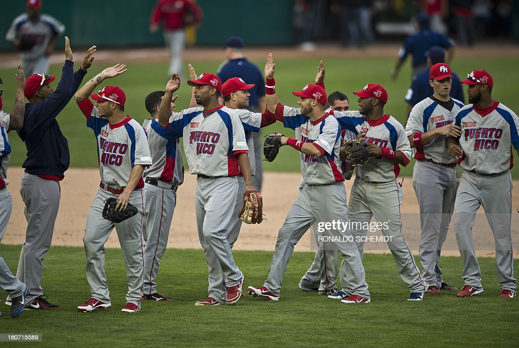 Players of Criollos de Caguas of Puerto Rico, celebrates his victory against Leones del Escogido of Dominican Republic, during the 2013 Caribbean baseball series, on February 4, 2013, in Hermosillo, Sonora State, in the northern of Mexico. AFP PHOTO/Ronaldo Schemidt