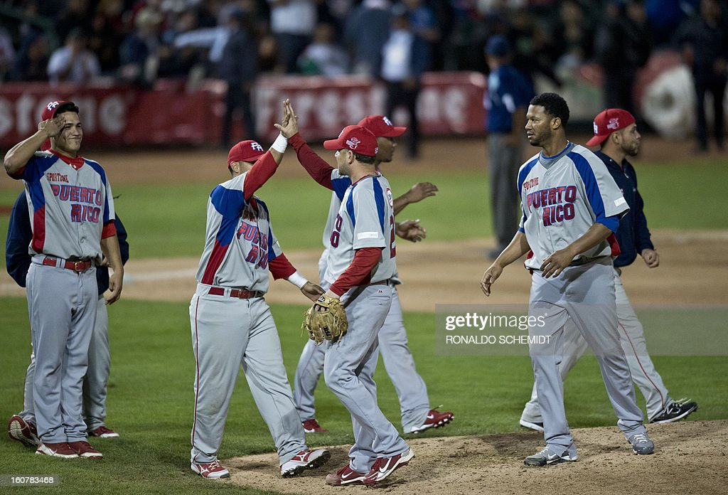 Players of Criollos de Caguas of Puerto Rico celebrates victory over Magallanes of Venezuela during the 2013 Caribbean baseball series, on February 5, 2013, in Hermosillo, Sonora State, in the northern of Mexico. AFP PHOTO/Ronaldo Schemidt