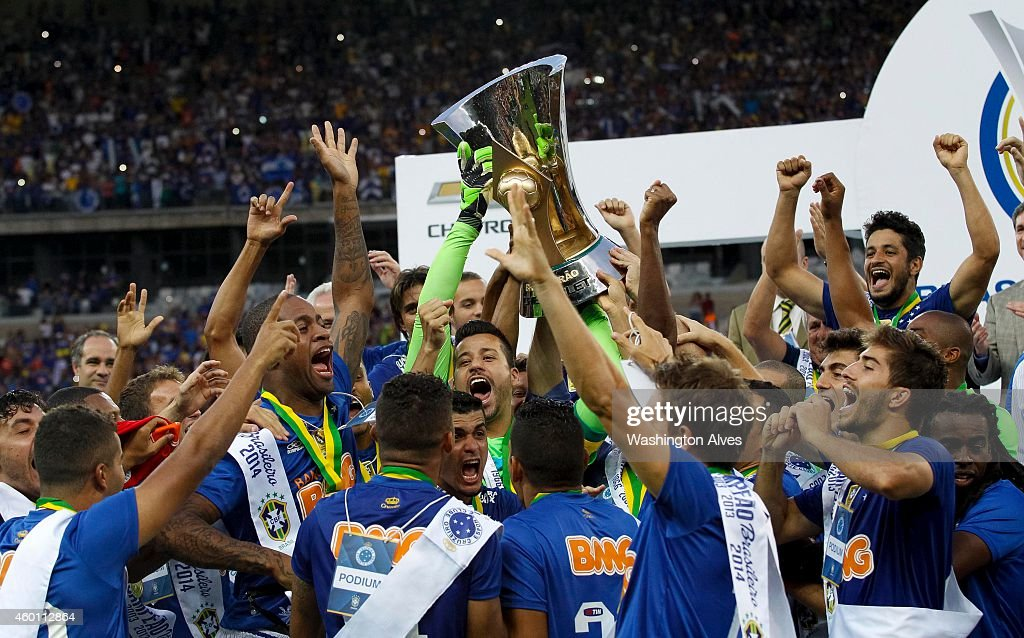 Players of Cruzeiro celebrate after winning the the cup of champions against Fluminense during the Brasileirao Series A 2014 at Mineirao Stadium on...