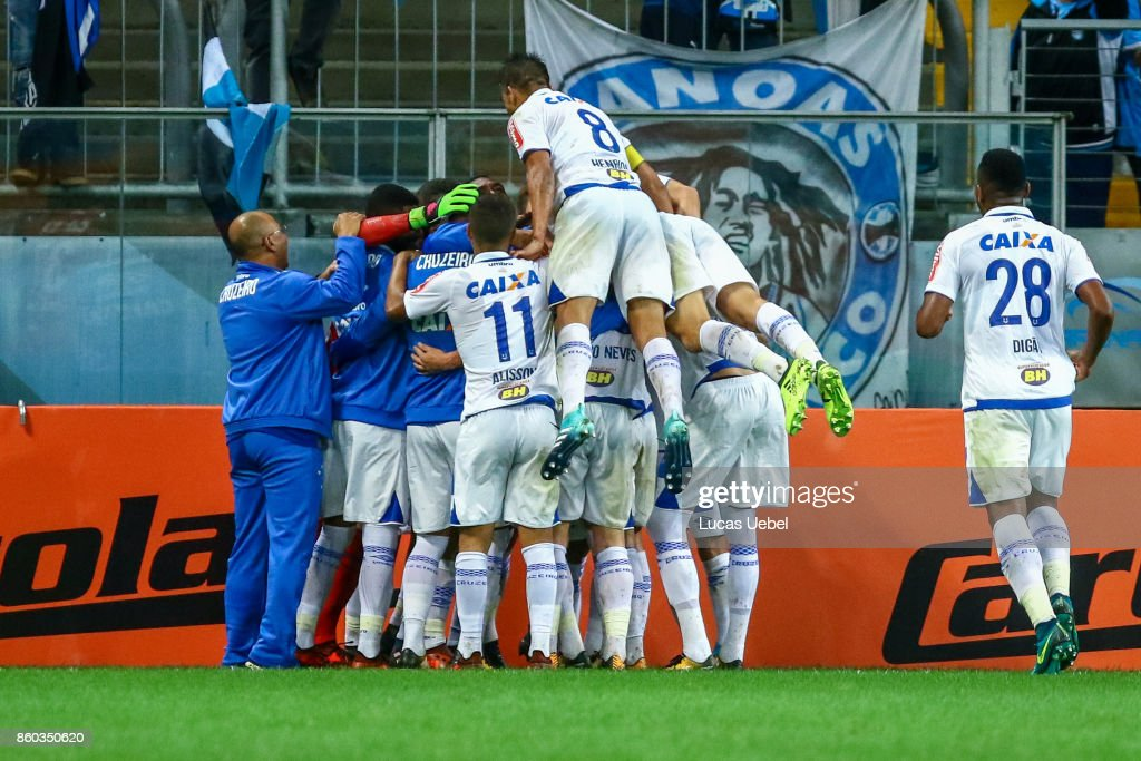 Players of Cruzeiro celebrate their first goal during the match Gremio v Cruzeiro as part of Brasileirao Series A 2017, at Arena do Gremio on October 11, 2017, in Porto Alegre, Brazil.