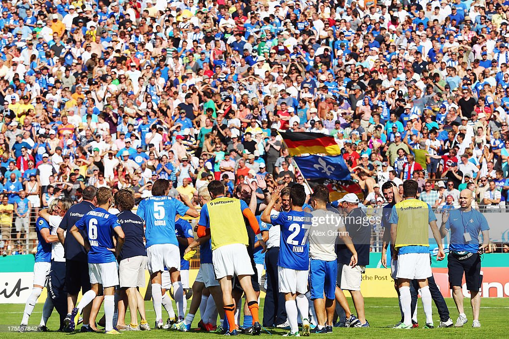Players of Darmstadt celebrate after the DFB Cup first round match between Darmstadt 98 and Borussia Moenchengladbach at Boellenfalltorstadion on August 4, 2013 in Darmstadt, Germany.