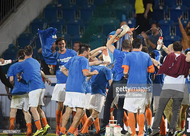 Players of Darmstadt celebrate after winning the Second Bundesliga Playoff Second Leg match between Arminia Bielefeld and Darmstadt 98 at Schueco...