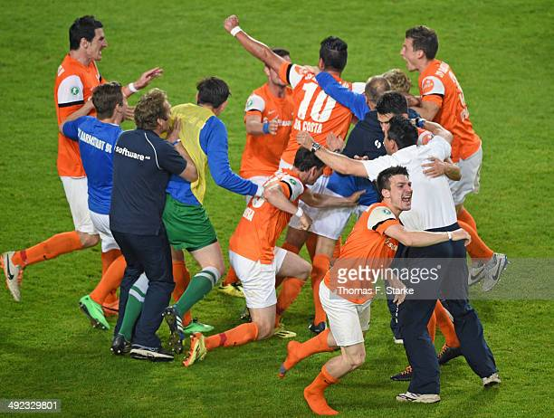 Players of Darmstadt celebrate during the Second Bundesliga Playoff Second Leg match between Arminia Bielefeld and Darmstadt 98 at Schueco Arena on...