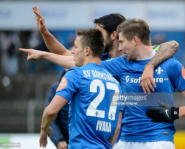 Players of Darmstadt celebrates after Benjamin Baier is scoring his teams second goal during the third league match between SV Darmstadt 98 and SV...
