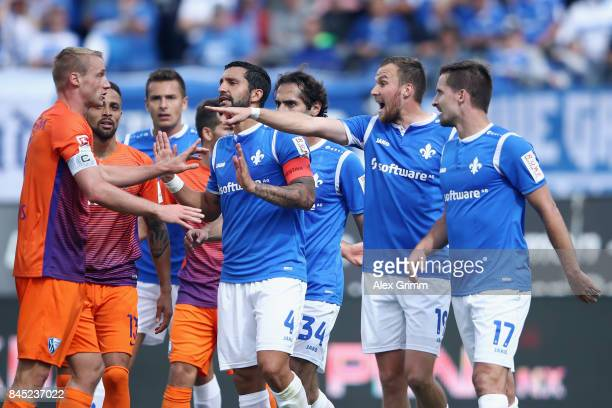 Players of Darmstadt discuss with Felix Bastians of Bochum during the Second Bundesliga match between SV Darmstadt 98 and VfL Bochum 1848 at...