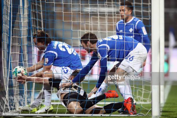 Players of Darmstadt get the ball after Patrick Banggaard scored his team's first goal during the Second Bundesliga match between SV Darmstadt 98 and...