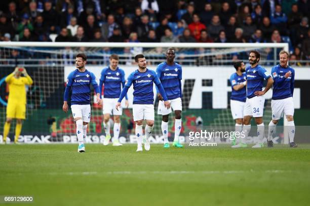 Players of Darmstadt react after Coke of Schalke scored his team's first goal during the Bundesliga match between SV Darmstadt 98 and FC Schalke 04...