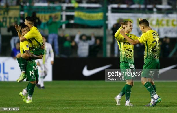 Players of Defensa y Justicia celebrate the first goal of his team scored by Nicolas Stefanelli of Defensa y Justicia during a first leg match...