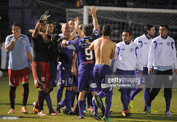Players of Defensor Sporting celebrate the victory against The Strongest during a second leg match between Defensor Sporting and The Strongest as...