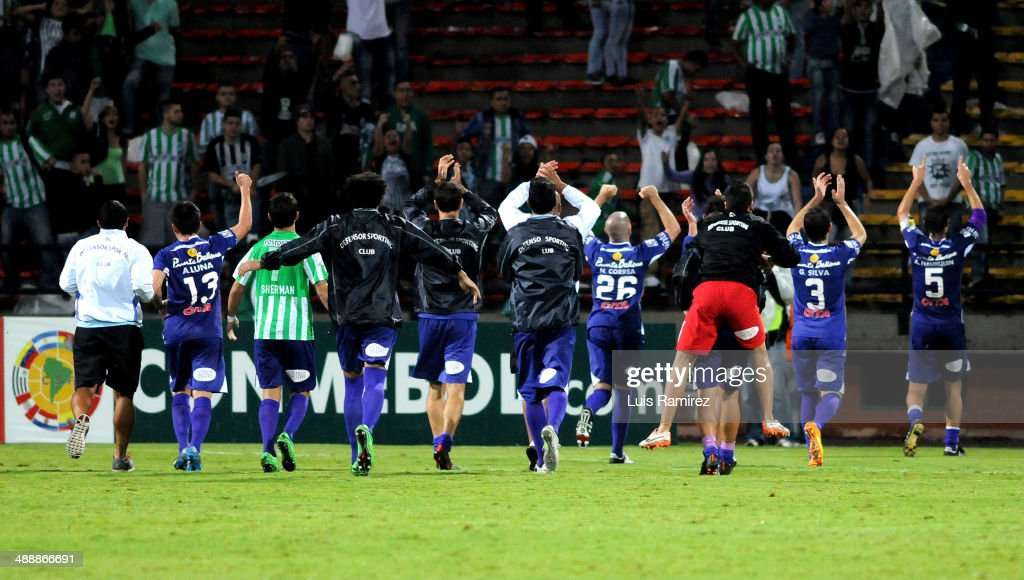 Players of Defensor Sporting celebrate their victory at the end of a quarterfinal match between Atletico Nacional and Defensor Sporting as part of Copa Bridgestone Libertadores 2014 at Atanasio Girardot Stadium on May 08, 2014 in Medellin, Colombia.