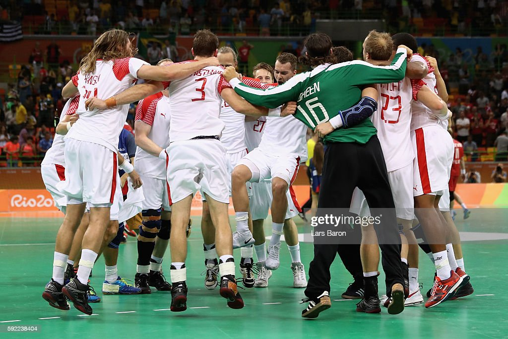 Players of Denmark celebrate their victory following the Men's Handball Semifinal match between Poland and Denmark on Day 14 of the Rio 2016 Olympic...
