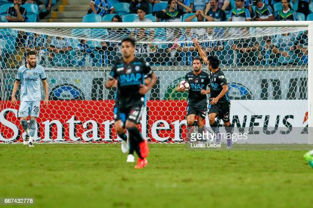 Players of Deportes Iquique celebrate their second goal during the match Gremio v Deportes Iquique as part of Copa Bridgestone Libertadores 2017 at...