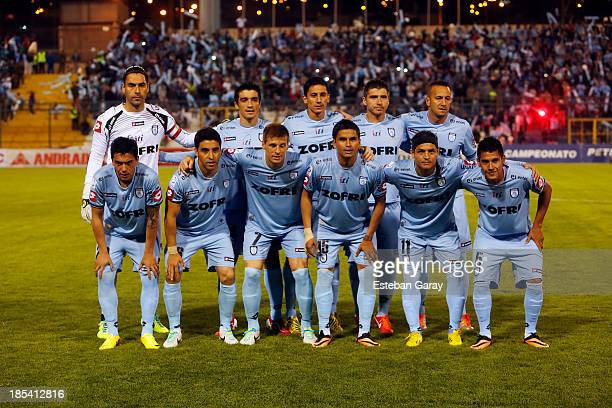 Players of Deportes Iquique pose for a team photo prior to a match between Deportes Iquique and Universidad de Chile as part of the Torneo Apertura...