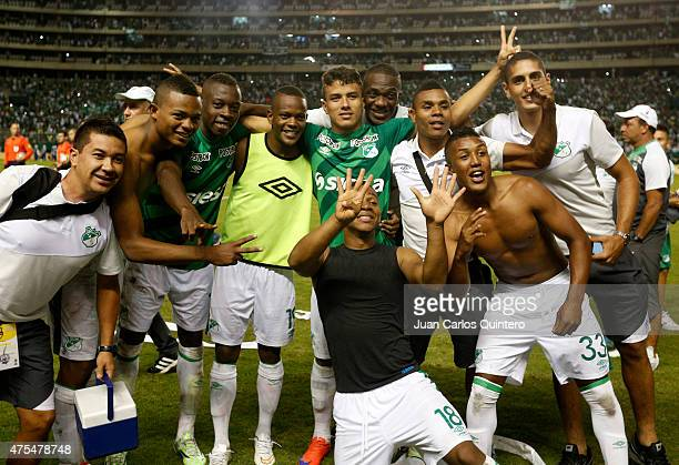 Players of Deportivo Cali celebrate after winning a second leg match between Deportivo Cali and Millonarios as part of final round of Liga Aguila I...