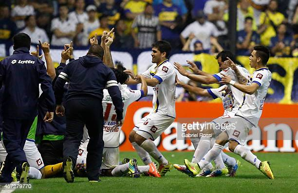 Players of Deportivo Capiata celebrate an own goal scored by Lisandro Magallán of Boca Juniors during a match between Boca Juniors and Deportivo...