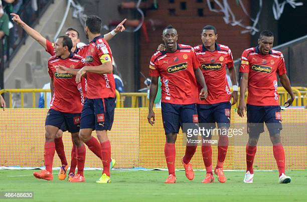 Players of Deportivo Independiente Medellin celebrate a scored goal to Atletico NacionaL during a match between Atletico Nacional and Deportivo...