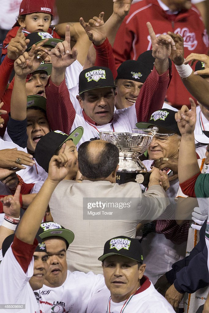 Players of Diablos celebrate after winning the championship during a match between Pericos de Puebla and Diablos Rojos as part of Serie del Rey...