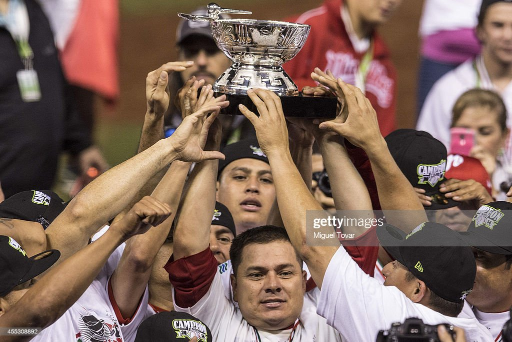 Players of Diablos celebrate with the Trophy after winning the during a match between Pericos de Puebla and Diablos Rojos as part of Serie del Rey...