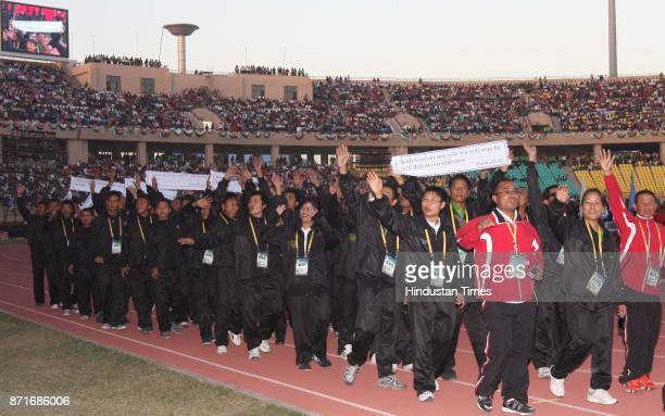 Players of different states take part in the march march past during the inagural function of 34th National Game at Birsa Munda Athletic stadium...