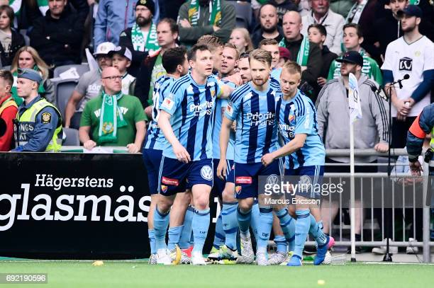 Players of Djurgardens IF celebrates after scoring 01 during the Allsvenskan match between Hammarby IF and Djurgardens IF at Tele2 Arena on June 4...