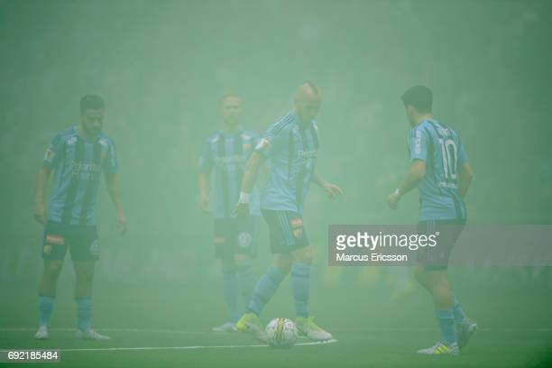 Players of Djurgardens IF waiting for smoke to clear ahead of the Allsvenskan match between Hammarby IF and Djurgardens IF at Tele2 Arena on June 4...
