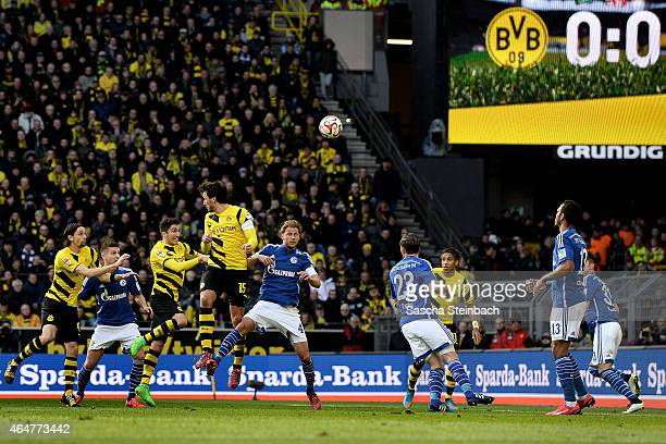 Players of Dortmund and Schalke jump for a header during the Bundesliga match between Borussia Dortmund and FC Schalke 04 at Signal Iduna Park on...