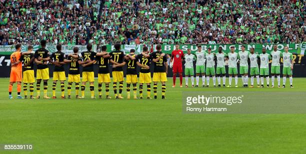 Players of Dortmund and Wolfsburg observe a minute's silence in memory of the victims of Thursday's terrorist attacks in Spain prior to the...