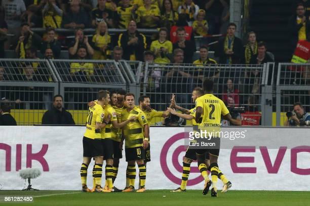 Players of Dortmund celebrate after PierreEmerick Aubameyang of Dortmund scored his teams first goal to make it 10 during the Bundesliga match...