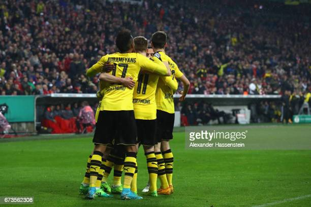 Players of Dortmund celebrate scoring the opening goal during the DFB Cup semi final match between FC Bayern Muenchen and Borussia Dortmund at...