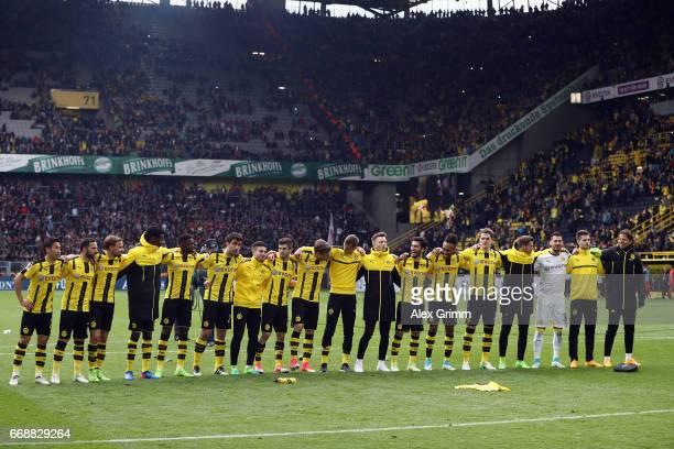 Players of Dortmund celebrate with the fans after the Bundesliga match between Borussia Dortmund and Eintracht Frankfurt at Signal Iduna Park on...