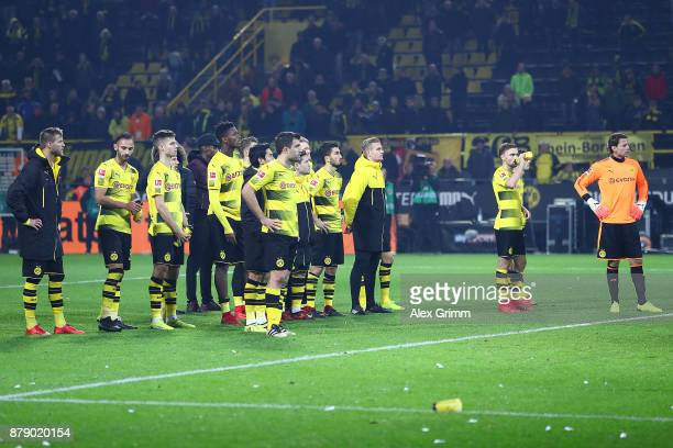 Players of Dortmund stand in front of their fans stand dejected after the Bundesliga match between Borussia Dortmund and FC Schalke 04 at Signal...