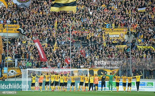 Players of Dresden celebrate in front of their supporters after the Third League match between SG Dynamo Dresden and Chemnitzer FC at Stadion Dresden...