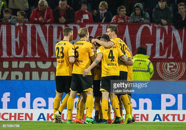 Players of Dresden celebrate the goal of Niklas Hauptmann of Dresden during the Second Bundesliga match between Fortuna Duesseldorf and SG Dynamo...