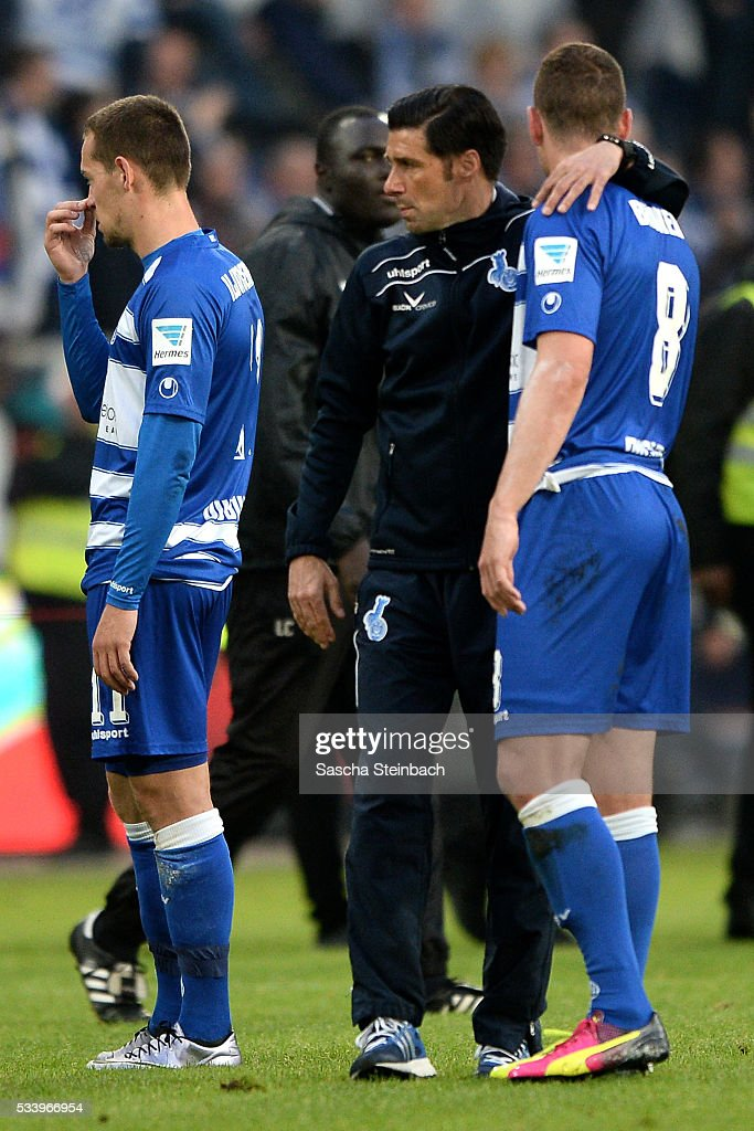 Players of Duisburg look dejected after losing the 2. Bundesliga playoff leg 2 match against Wuerzburger Kickers at Schauinsland-Reisen-Arena on May 24, 2016 in Duisburg, Germany.
