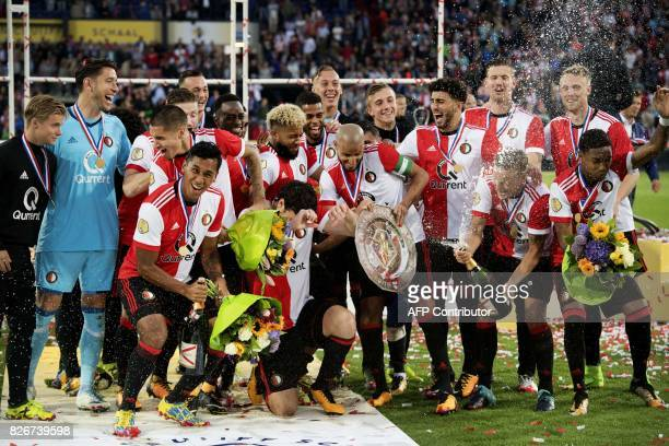 Players of Dutch soccer team Feyenoord celebrate after winning the Johan Cruijff Schaal Cup football match against Vitesse during the first match of...