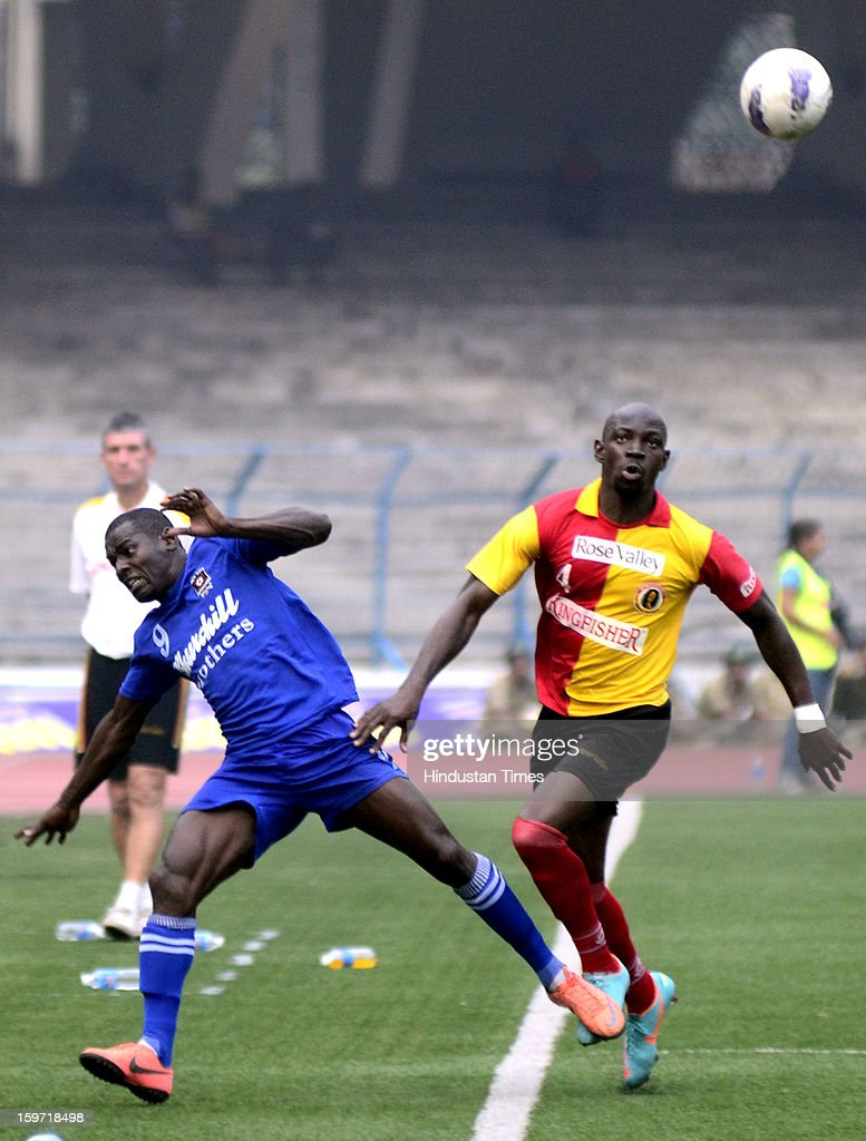 Players of East Bengal & Churchill Brothers vying for ball during I-League Football Match, at Yuba Bharati Krirangan, on January 19, 2013 in Kolkata, India.