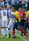 Players of Ecuador and the USA argue before Colombian referee Wilmar Roldan expels USA's Jermaine Jones and Ecuador's Enner Valencia during the Copa...