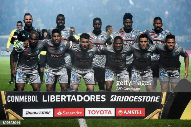 Players of Ecuador's team Emelec pose for pictures before their Copa Libertadores round of 16 second leg football match against Argentina's San...