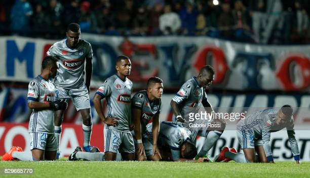 Players of Emelec watch the penalty shootout during a second leg match between San Lorenzo and Emelec as part of round of 16 of Copa CONMEBOL...