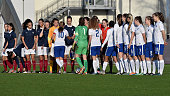 Players of England and France shake hands prior to the U17 girl's international friendly match between France and England on December 19 2015 in...