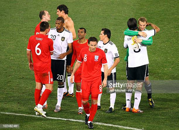 Players of England and Germany shake hands after the 2010 FIFA World Cup South Africa Round of Sixteen match between Germany and England at Free...