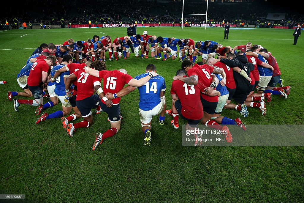 Players of England and Samoa huddle following the final whistle in the QBE international match between England and Samoa at Twickenham Stadium on...