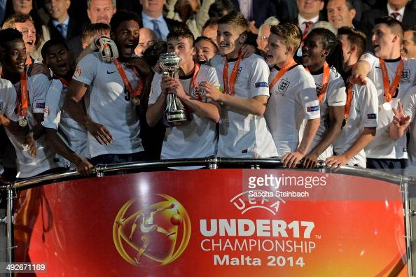 Players of England celebrate with the trophy after winning the UEFA Under17 European Championship 2014 final match against Netherlands at Ta' Qali...