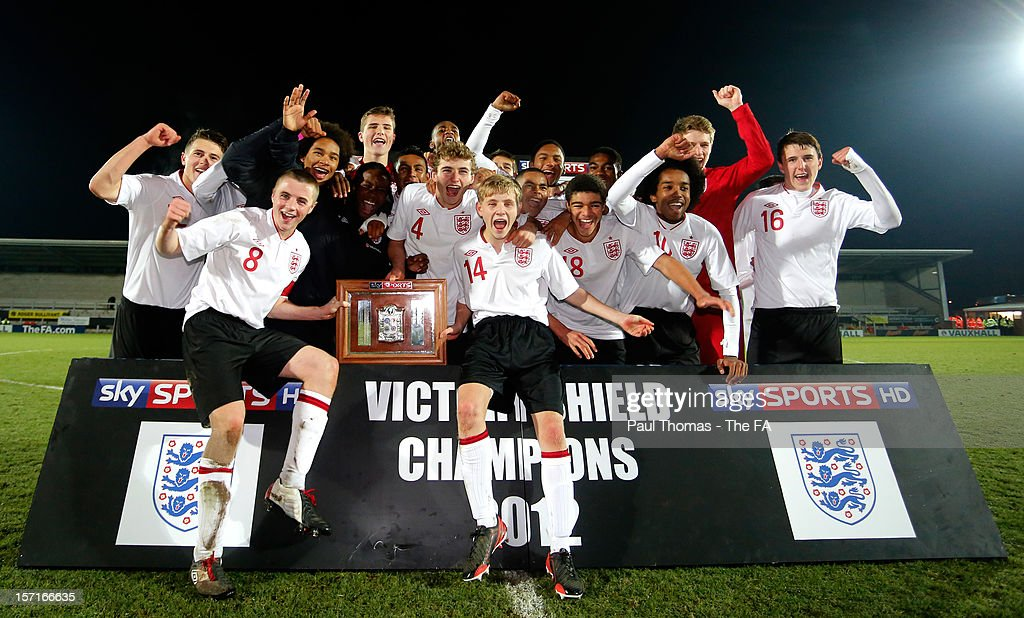 Players of England U16 team celebrate with trophy after the Sky Sports Victory Shield match between England U16 and Scotland U16 at Pirelli Stadium on November 29, 2012 in Burton-upon-Trent, England.