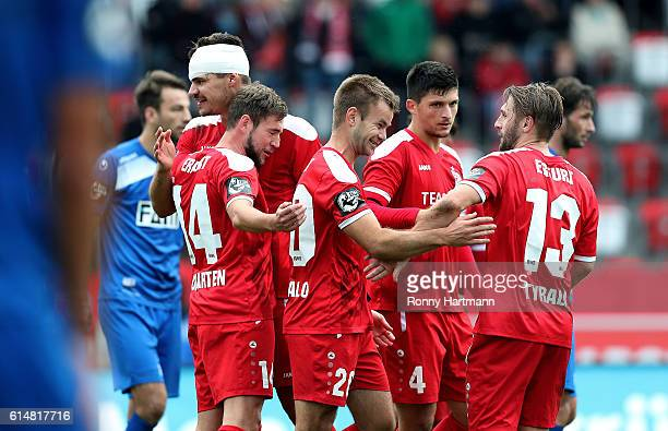 Players of Erfurt celebrate during the Third League match between FC Rot Weiss Erfurt and 1 FC Magdeburg at Steigerwald stadium on October 15 2016 in...