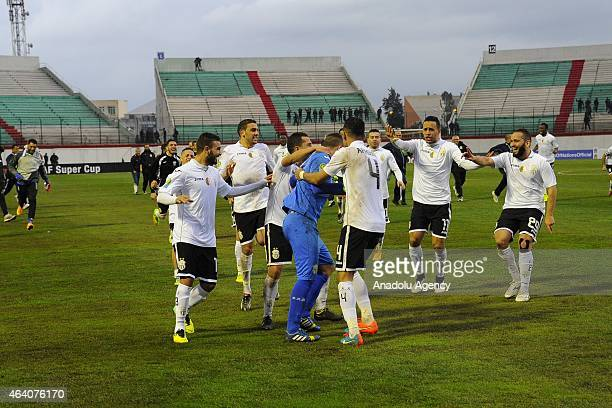 Players of Es Setif celebrate after scoring during the African Super Cup match between CAF Champions League winner Algeria's ES Setif and CAF...